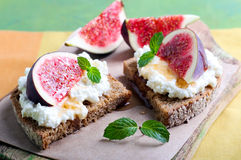 Bread with cheese and fresh figs Stock Photo