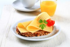 Bread with cheese and orange juice Stock Image