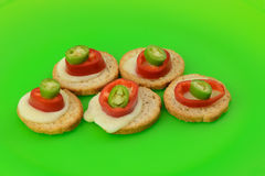 Bread, cheese and pepper appetizers Stock Images