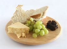 Bread cheese pickle grapes Stock Photo