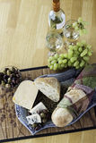 Bread and cheese platter Royalty Free Stock Images