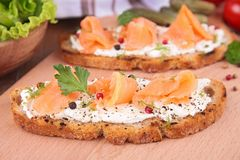 Bread with cheese and salmon. On board Stock Photos
