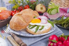 Bread with cheese, salmon and asparagus. Different Healthy Eating. Delicious breakfast for the family. Food in the Netherlands. Bread with cheese, salmon and Royalty Free Stock Photography