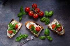 Bread cheese spread baked tomato Royalty Free Stock Images