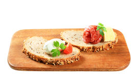 Bread with cheese spread and salami Royalty Free Stock Photography