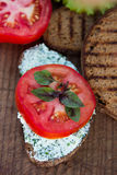 Bread with cheese and tomato. Bread with cheese and herbs and tomato Royalty Free Stock Photo