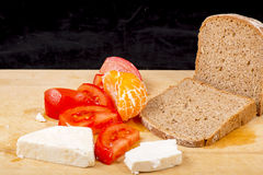 Bread, cheese, tomato Stock Images