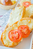 Bread. Cheese bread with tomato on top in white dish Stock Images