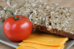 Bread, Cheese, Tomatoes. Layout of bread, cheese, tomatoes Stock Photos
