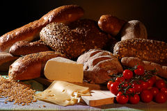 Bread, cheese and tomatoes Stock Photos