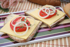 Bread with cheese and tomatoes Stock Image
