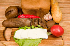 Bread,   cheese  and vegetables. Stock Photography