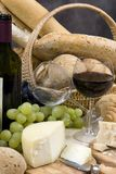 Bread Cheese and Wine 6. Two glasses of chianti wine with assorted breads and cheeses royalty free stock images
