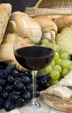 Bread Cheese and Wine 8. A glass of Chianti wine and assorted breads and cheeses royalty free stock photos