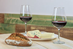 Bread, cheese and wine glasses Stock Photos
