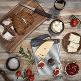 Bread with cheeses and grapes on wooden background Stock Photo