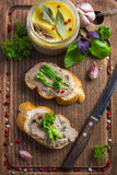 Bread with chicken liver pate on wooden cutting board Stock Photo