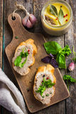 Bread with chicken liver pate on wooden cutting board Royalty Free Stock Photos