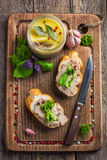 Bread with chicken liver pate on wooden cutting board Royalty Free Stock Image