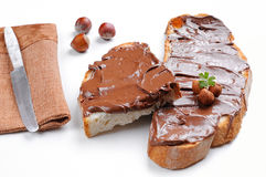 Bread with chocolate cream and hazelnuts white isolated Royalty Free Stock Images