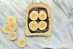 Bread with chocolate cream and slices of banana Stock Photo