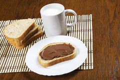 Bread with chocolate spread. Milk and hazelnuts Royalty Free Stock Images