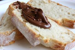 Bread with chocolate spread Royalty Free Stock Photos