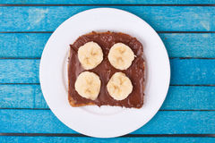Bread with chocolate spread and banana Stock Images