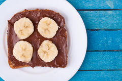 Bread with chocolate spread and banana Royalty Free Stock Photography
