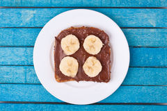 Bread with chocolate spread and banana Royalty Free Stock Photo