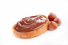 Bread and chocolate spread. Isolated Stock Images