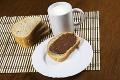 Bread with chocolate spread milk. And hazelnuts Royalty Free Stock Photos