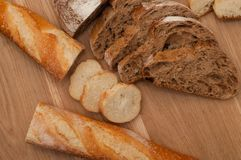 Bread chopped on wooden board with space for text Royalty Free Stock Photography