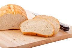 Bread on chopping board isolated on white Stock Photo
