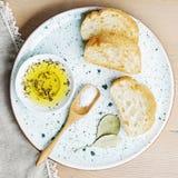 Bread ciabatta and bowl of olive oil Stock Photo