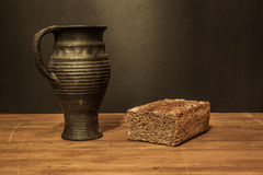 Bread and clay jug Stock Image