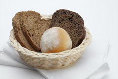 Bread. Close up view of some bread in small basket  on whit back Royalty Free Stock Photos