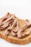 Bread coated with pate Stock Image