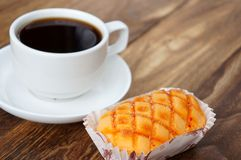 Bread with coffee. On wooden background Royalty Free Stock Photo
