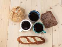 Bread  in  coffee cup on wood Royalty Free Stock Images