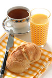Bread with coffee and juice Royalty Free Stock Image