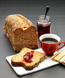Bread and coffee. Wheat bread on porcelain murals within table with coffee and jam Royalty Free Stock Photography