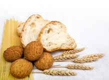 Bread composition. With grain on white fabric background Royalty Free Stock Photo