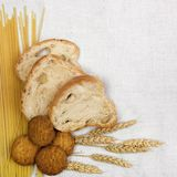 Bread composition. With grain on white fabric background Stock Image