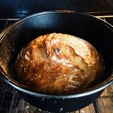 Bread cooking in a dutch oven Royalty Free Stock Images