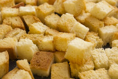 Bread crackers on a baking sheet. Bread crumbs on a baking sheet, roast crackers royalty free stock photos