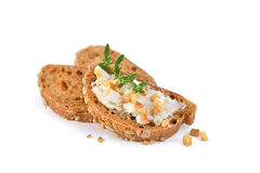 Bread with crackling lard. Hearty bread appetizers: Spicy German crackling lard on small rye bread slices garnished with thyme leaves Royalty Free Stock Photo