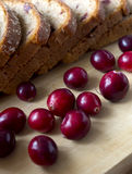 Bread with cranberries on a wooden board Stock Photos