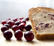 Bread with cranberries on a wooden board Royalty Free Stock Photo
