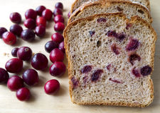 Bread with cranberries on a wooden board Royalty Free Stock Photos